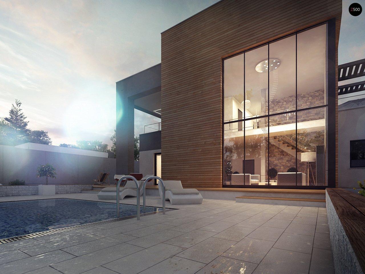 Современный двухэтажный дом с большой площадью остекления. - фото 2