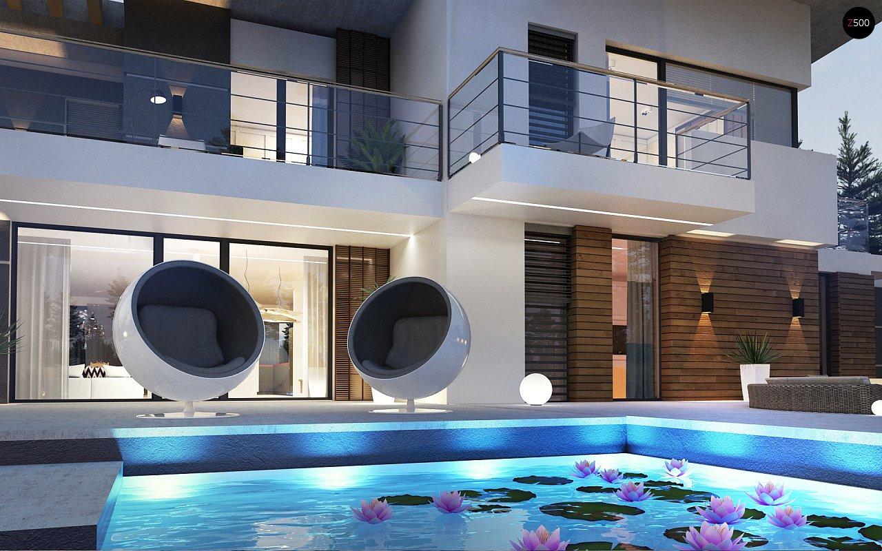 Современный двухэтажный дом с гаражом и террасой, спальней на первом этаже и ванной комнатой 8