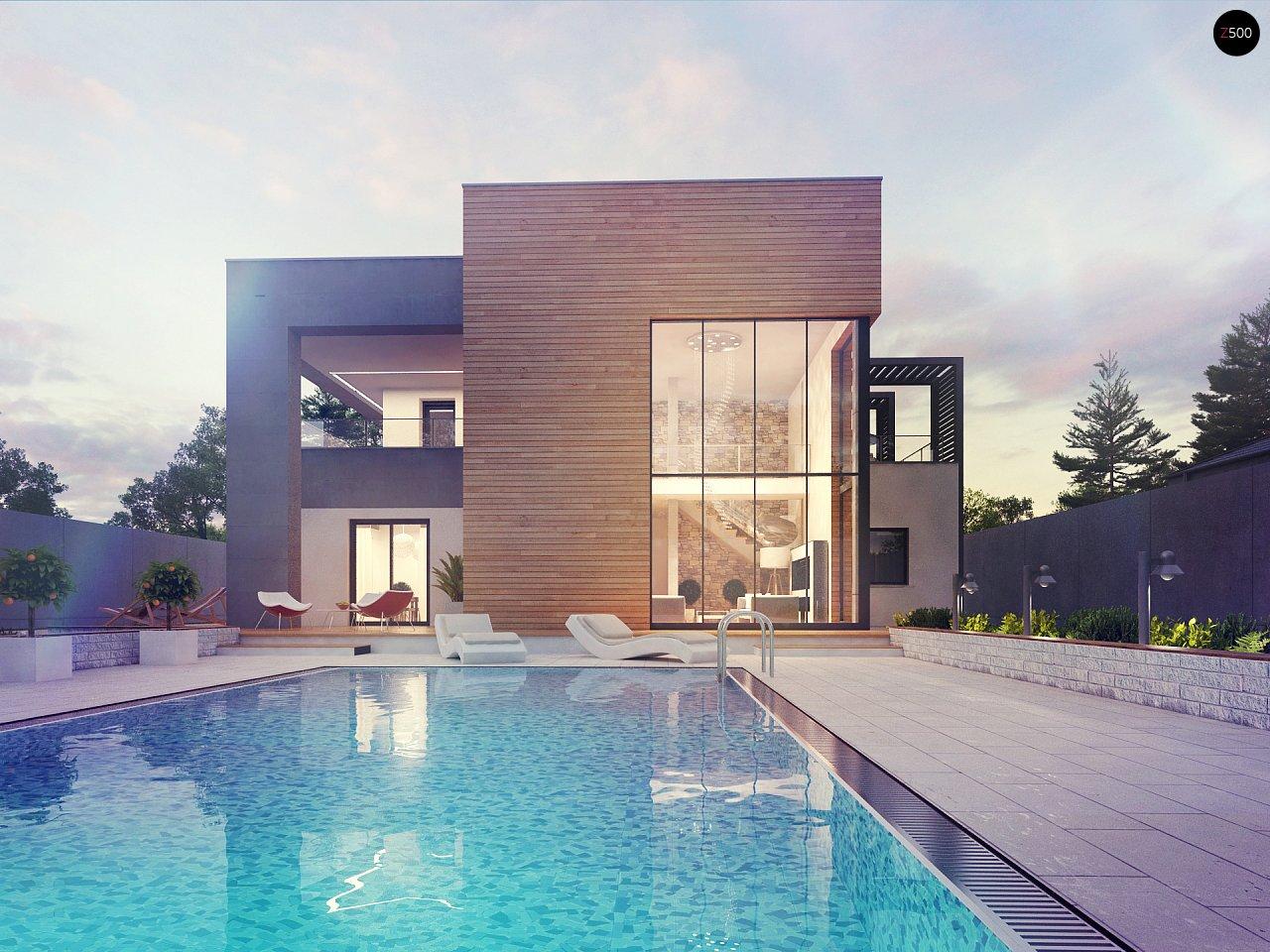 Современный двухэтажный дом с большой площадью остекления. - фото 4