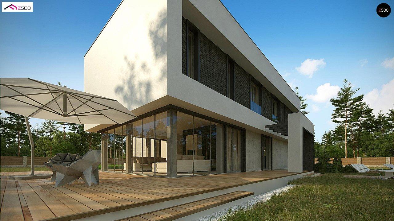 Современный двухэтажный дом с просторной террасой и гаражом на две машины. - фото 4