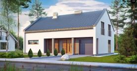 Аккуратный современный дом простой формы с оригинальной двускатной крышей.